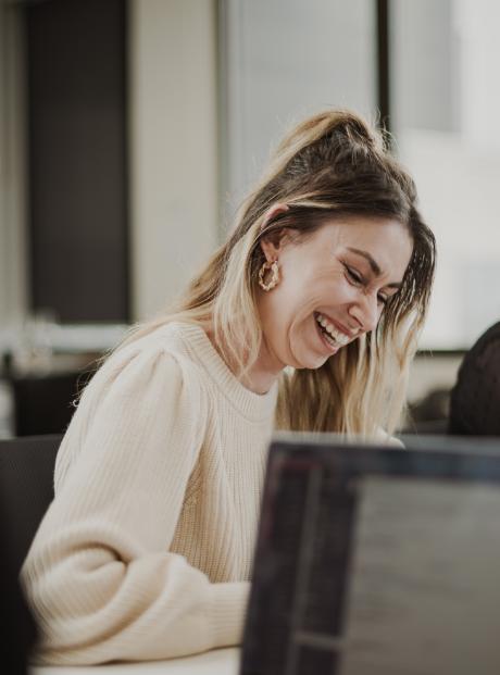 Women smiling at computer
