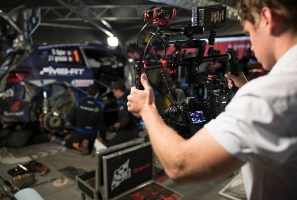 Camera man and rally car